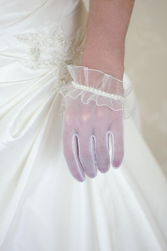 white tulle gloves with ruffles and a row of pearls look refined and chic and bring a romantic touch