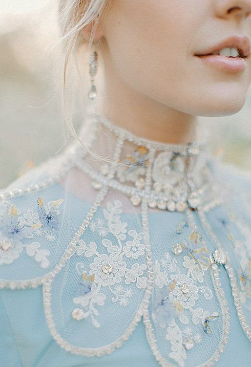 a boho winter wedding dress in blue with pretty detailing - lace appliques, beading and embroidery for a wow effect