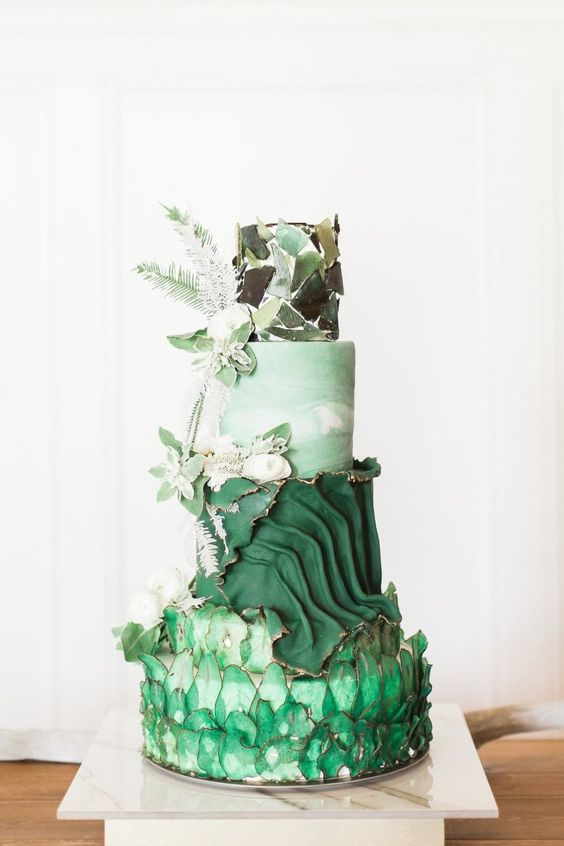 a cake masterpiece in green shades, with sugar glass shards, a textural tier, a marble and a glass shard one plus fresh and sugar blooms