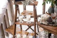 a cozy milk and cookies food and drink station with a chalkboard sign and pale millet for a rustic winter wedding