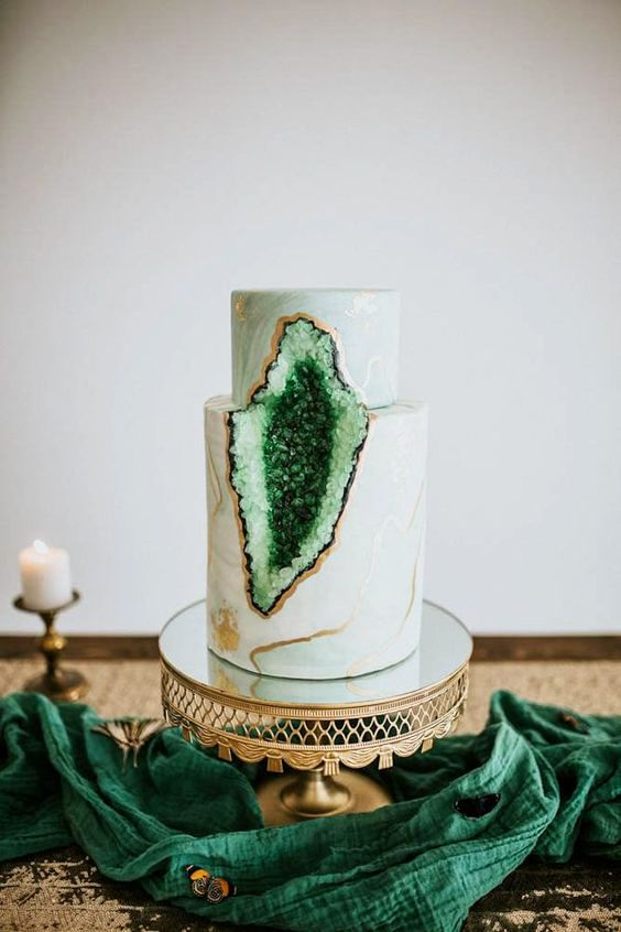 a marble wedding cake with green geode detailing and copper touches is a fresh modern idea to rock