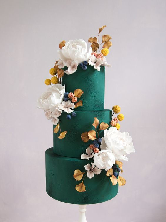 a matte emerald wedding cake with billy balls, white blooms and gall leaves plus berries for a refined modern wedding