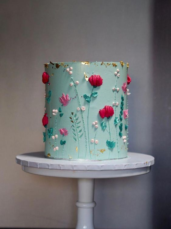 a mint green wedding cake decorated with colorful dimensional sugar blooms and beads is a pretty idea for a summer wedding