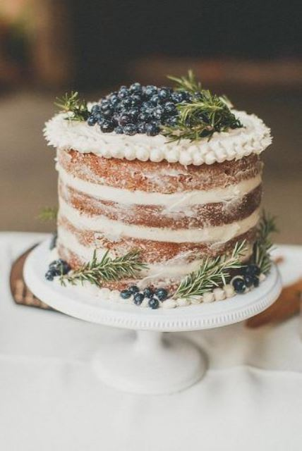 a naked wedding cake with greenery and blueberries is a lovely idea for a woodland or rustic wedding