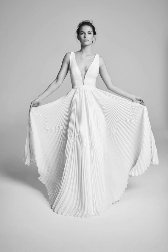 an A-line wedding gown with a plain bodice and a pleated maxi skirt is a very sexy option to try