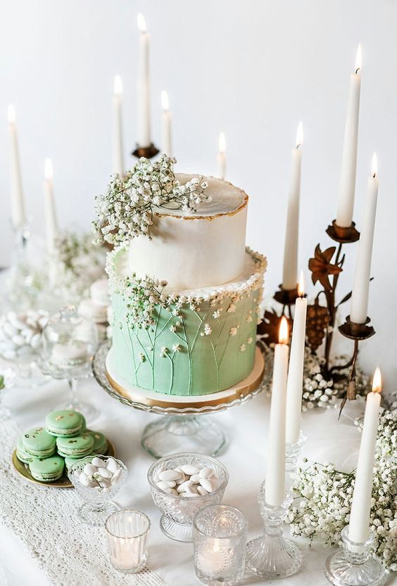an ethereal white and green wedding cake topped with baby's breath and sugar baby's breath for a romantic spring wedding