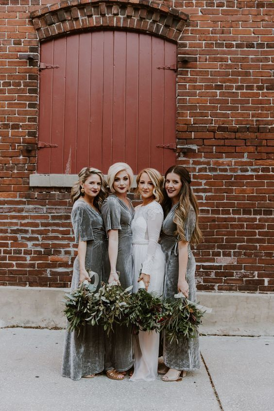 grey velvet maxi bridesmaid dresses with short sleeves and nude shoes for a chic winter wedding