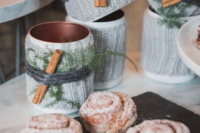 serve cinnamon buns and hot chocolate in copper mugs wrapped in knit, twine and cinnamon bark