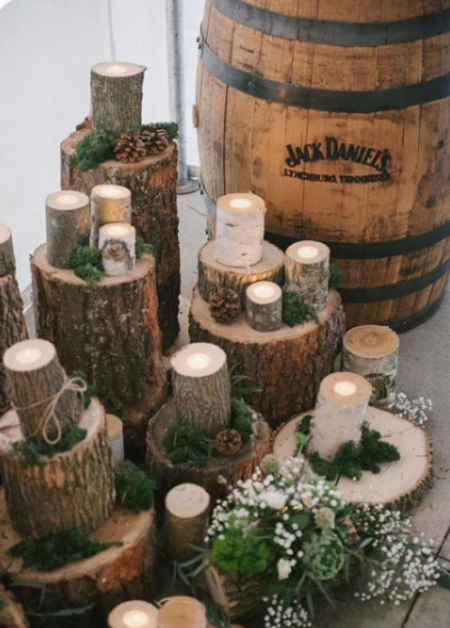 tree stumps and wood slices, moss, greenery and white blooms plus candles for chic and cozy rustic decor