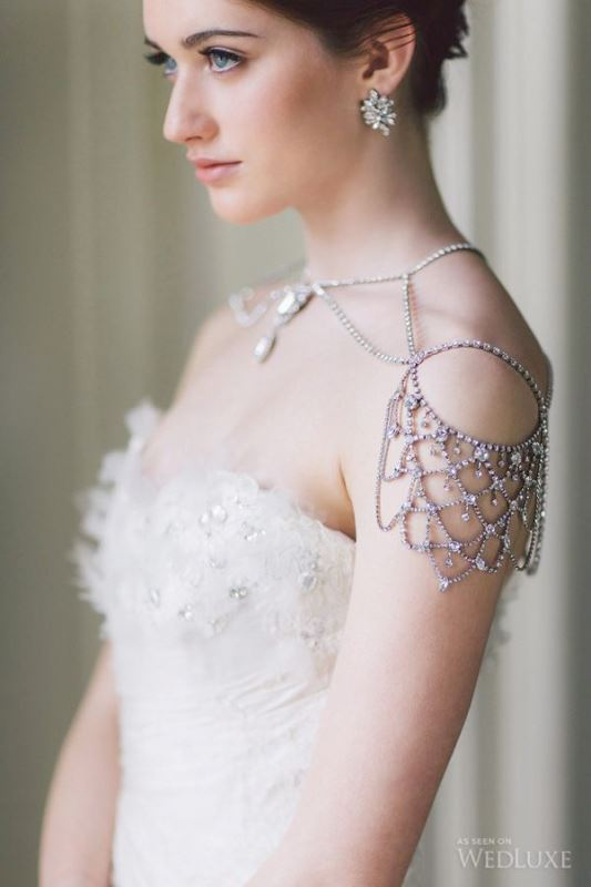 elegant shoulder jewelry plus a necklace with statement rhinestones in one for accenting a bridal look with a strapless wedding dress