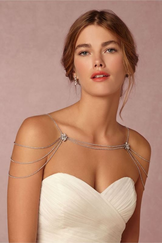 a chic and delicate rhinestone shoulder jewelry piece with smaller and larger gems for a subtle touch of chic