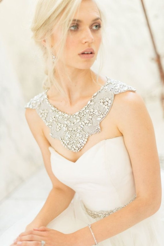 a statement rhinestone and beads collar and shoulder jewelry piece is a stylish glam idea with a vintage feel