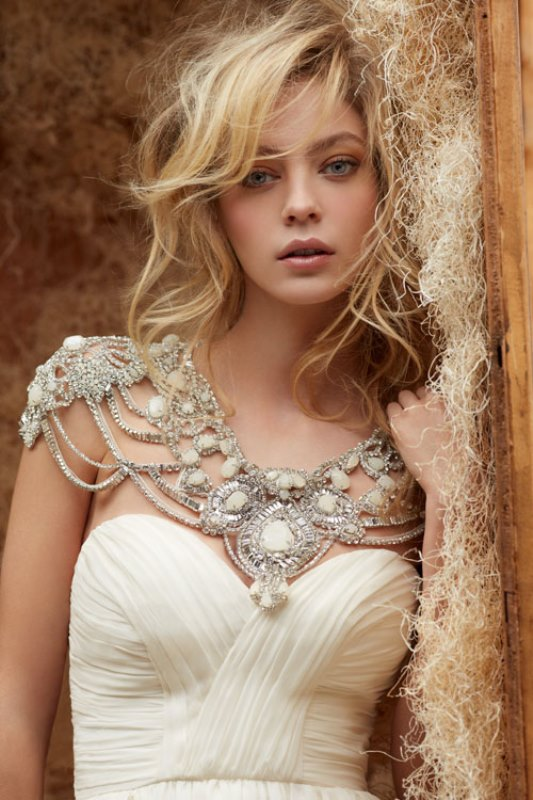 a jaw-dropping silver thread, embellishments and oversized rhinestone shoulder jewelry piece will make your look unforgettable