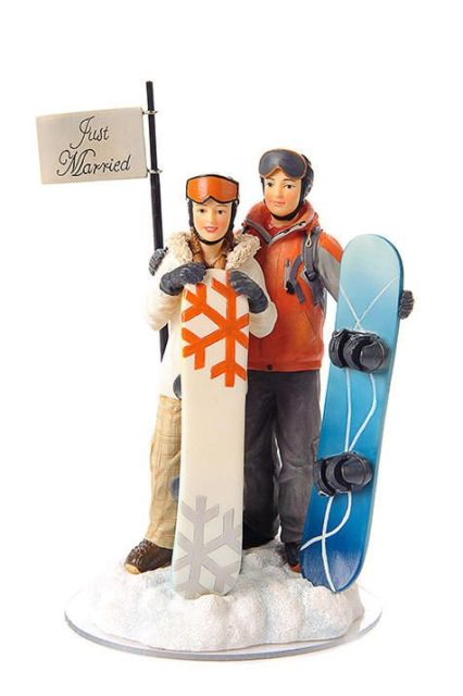 a creative wedding cake topper showing off the couple with their snowboards