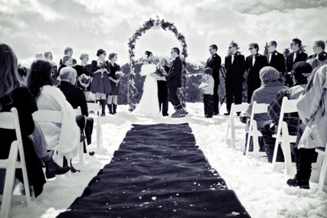 a cool wedding ceremony on top the mountain for a snowboard wedding