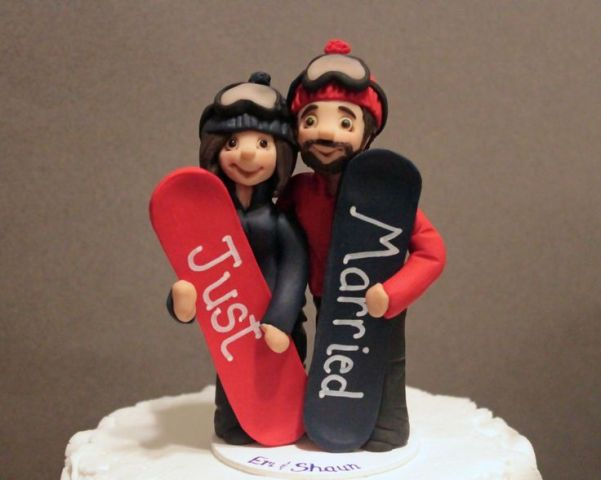 bright wedding cake toppers with colorful snowboards and Just Married on them