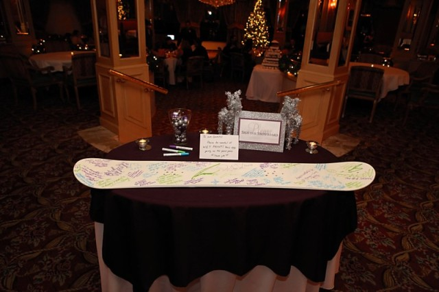 a simple and fun wedding guest book made of a neutral snowboard will highlight your wedding theme
