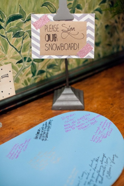 a fun snowboard wedding guest book with a marking sign is great for a modern snowboard wedding