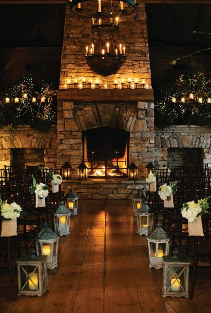 candles, a candle chandelier, candles lanterns and lights make this cozy rustic space very welcoming