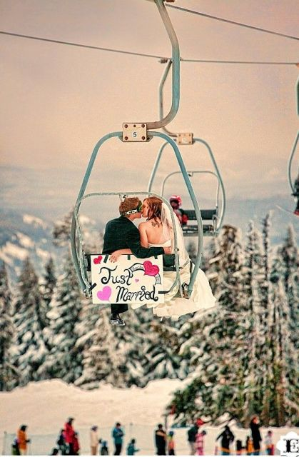 take a pic with a ski lift and Just Married sign instead of a usual car - this is a cool getaway for a ski resort wedding