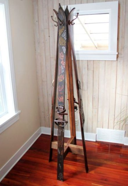 use skis with wishes to make a clothes rack for your home - this way these wishes won't be wasted