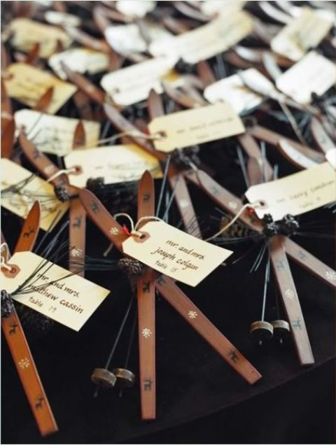skis and ski poles plus tags as seating cards double as wedding favors at a ski resort wedding