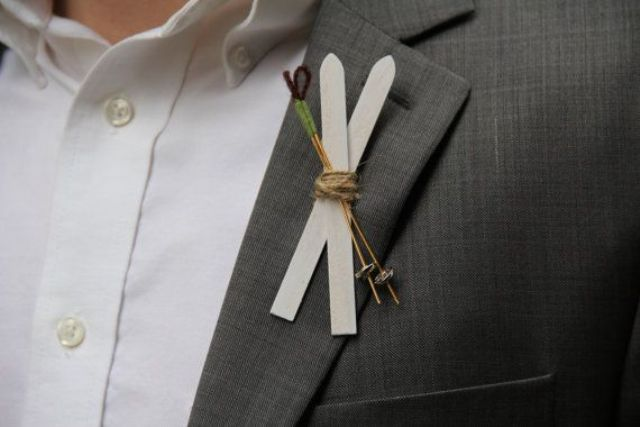 a simple ski and ski pole boutonniere to spruce up the look of the groom