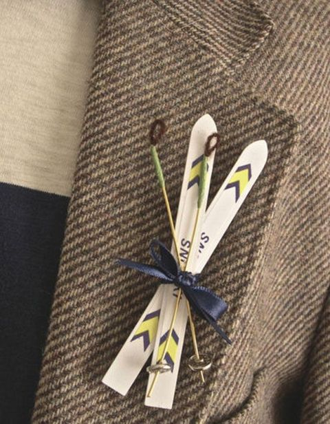 a ski boutonniere is a pretty and chic idea for a groom who wants a ski resort wedding