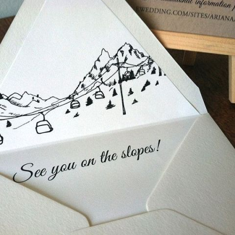 an elegant black and white wedding invitation suite with cool printing to embrace the location is ultimate