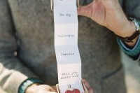 a groom popping up the question in a creative way – with a box with letters and hearts is a lovely vintage-inspired idea