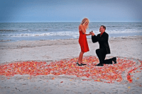 a romantic Valentine engagement on the beach in a heart made of petals is a cool and timeless idea for a Valentine's Day