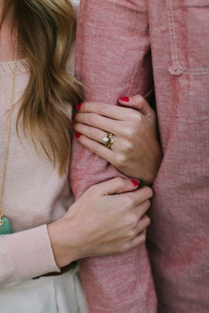 show off your engagement ring hugging your love - this is a very original Valentine photo idea