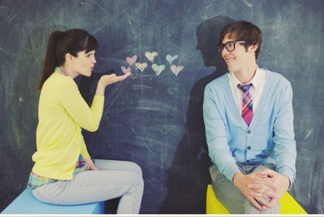 a chalkboard with pastel hearts is always a good idea for a Valentine engagement and it doesn't look boring