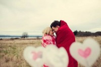 cozy up in pretty red and pink blankets, add some hearts, and a cool Valentine engagement photo is ready