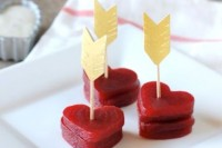 heart-shaped beet stacks topped with gold arrows are lovely Valentine wedding appetizers to enjoy