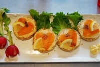 tartlets with cream cheese and heart-shaped salmon on top are delicious Valentine wedding appetizers that look sweet
