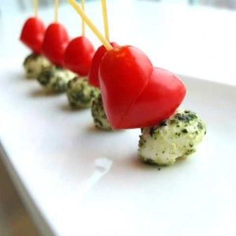 Valentine Caprese skewers with herbed mozzarella cheese and heart-shaped tomatoes are fun and lovely appetizers for a Valentine wedding