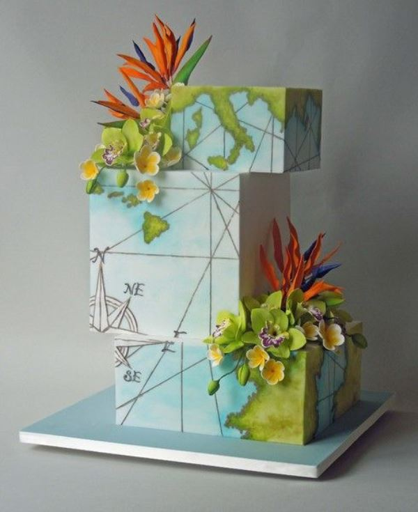 a bright square world map wedding cake with bold tropical blooms is a fun idea for travelling