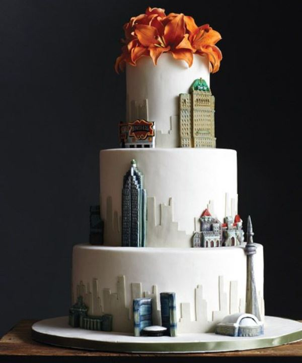 a white wedding cake with sugar detailign that shows off your favorite city - New York
