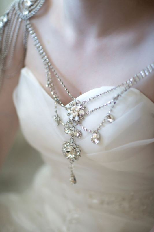 a very delicate with rhinestone epaulettes and a chic necklace with large embellishments is a romantic piece