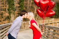 a Valentine's Day engagement with a bunch of red heart balloons is a fun and cool idea for now