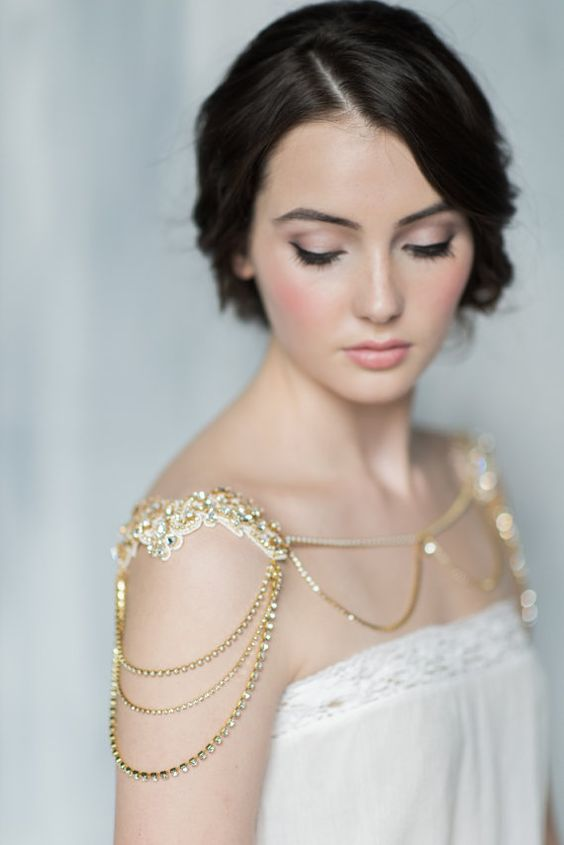 a beautiful gold embellished shoulder chain piece is a romantic and shiny idea for accenting a look