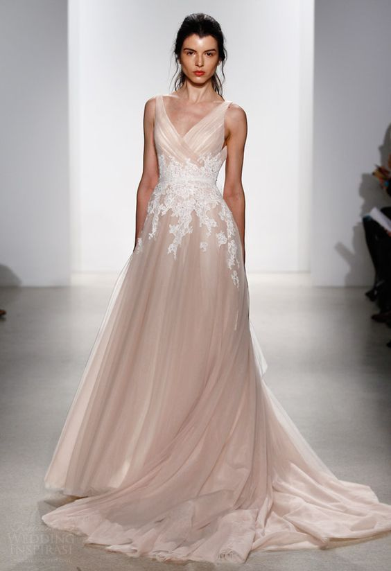 a blush A-line wedding dress with thick straps, a V-neckline, a train and white floral lace appliques is chic