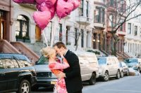 a bright floral dress, hot pink shoes and a bunch of pink heart balloons for your Valentine's Day engagement