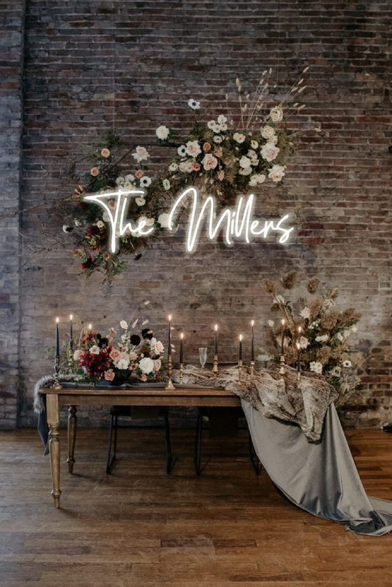 a chic industrial wedding space with shabby brick walls finished with refined furniture, luxurious florals and black candles