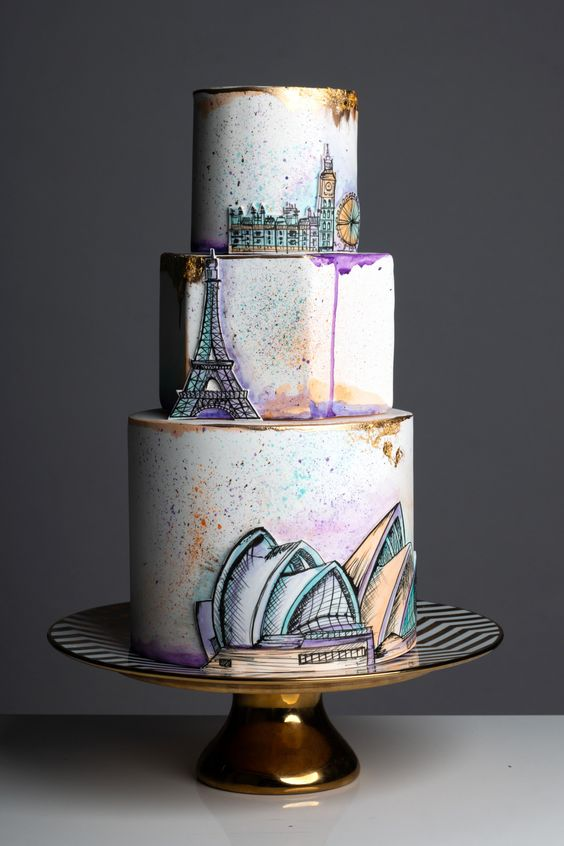 a creative wedding cake featuring your couple's favorite cities and some bright drip, too