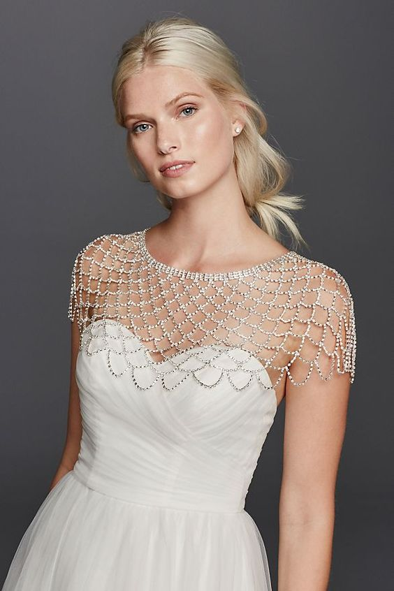 a crystal and silver chain body jewelry is a great accent to any strapless dress, it will make your look more special