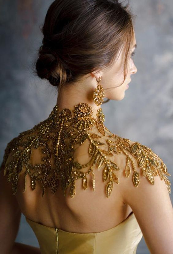 a gold beads and rhinestones shoulder cover with a high collar is a jaw-dropping piece to try
