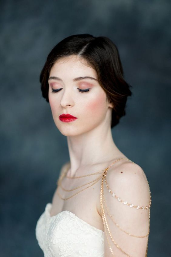 a gold chain and rhinestone shoulder jewelry piece will give a slight boho touch to the bridal look