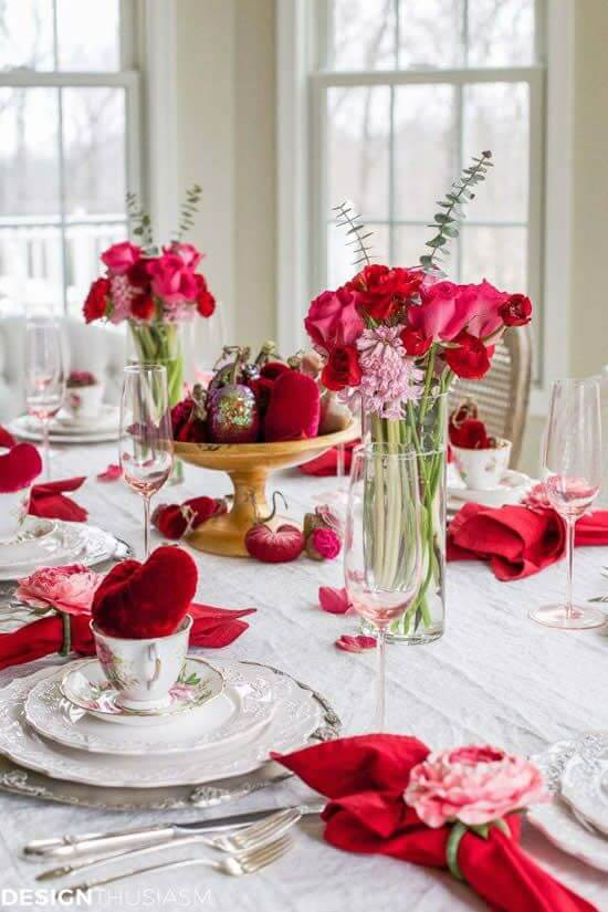 a gorgeous Valentine engagement tablescape with plush red hearts, pink and blooms blooms and vintage porcelain